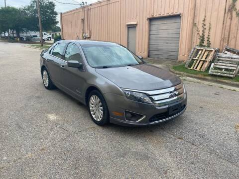 2012 Ford Fusion Hybrid for sale at Horizon Auto Sales in Raleigh NC