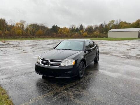 2012 Dodge Avenger for sale at Caruzin Motors in Flint MI