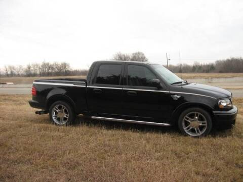 2003 Ford F-150 for sale at CAVENDER MOTORS in Van Alstyne TX