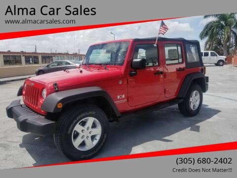 2009 Jeep Wrangler Unlimited for sale at Alma Car Sales in Miami FL