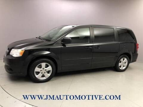 2013 Dodge Grand Caravan for sale at J & M Automotive in Naugatuck CT