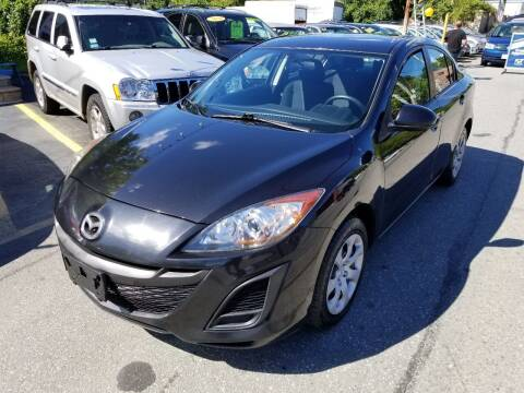 2011 Mazda MAZDA3 for sale at Howe's Auto Sales in Lowell MA