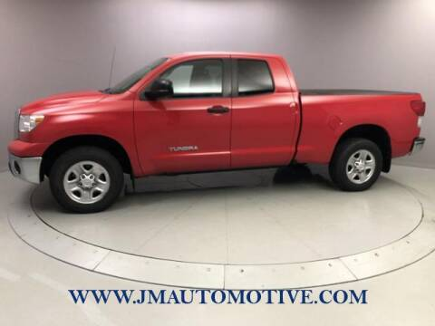 2013 Toyota Tundra for sale at J & M Automotive in Naugatuck CT