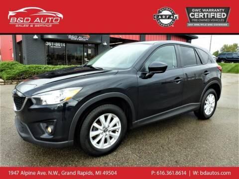 2013 Mazda CX-5 for sale at B&D Auto Sales Inc in Grand Rapids MI