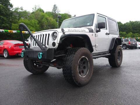 2009 Jeep Wrangler for sale at Mulligan's Auto Exchange LLC in Paxinos PA