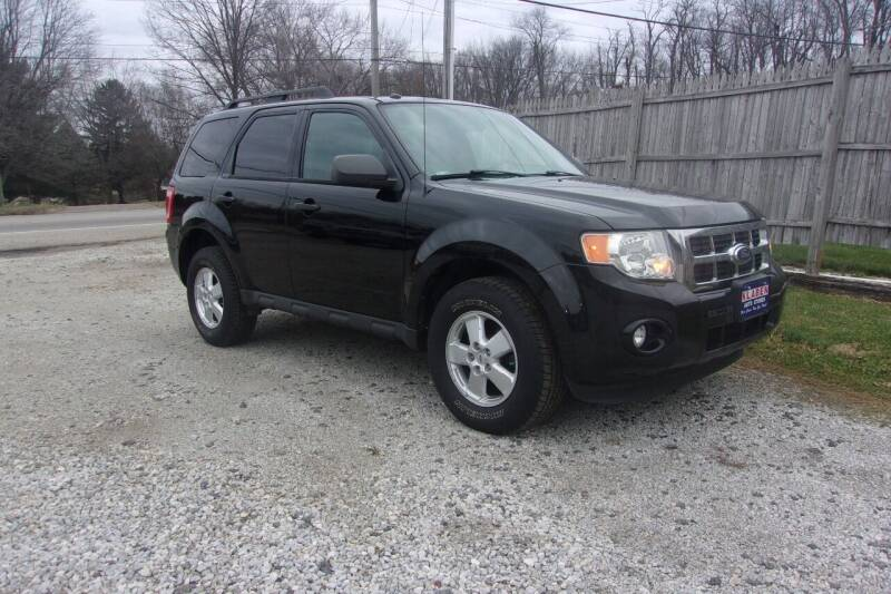 2010 Ford Escape for sale at JEFF MILLENNIUM USED CARS in Canton OH