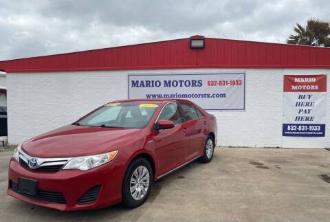 2014 Toyota Camry Hybrid for sale at Mario Motors in South Houston TX