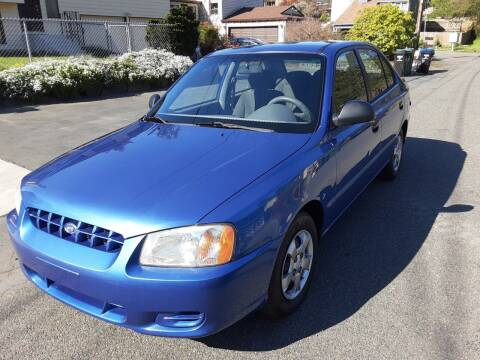 2002 Hyundai Accent for sale at METROPOLITAN MOTORS in Kirkland WA