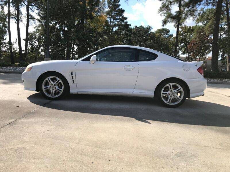 2006 Hyundai Tiburon for sale at ALL AMERICAN FINANCE AND AUTO in Houston TX