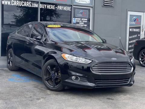 2016 Ford Fusion for sale at CARUCARS LLC in Miami FL