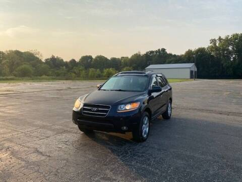 2009 Hyundai Santa Fe for sale at Caruzin Motors in Flint MI