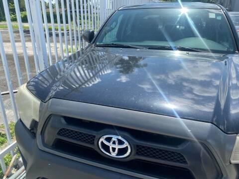 2014 Toyota Tacoma for sale at America Auto Wholesale Inc in Miami FL
