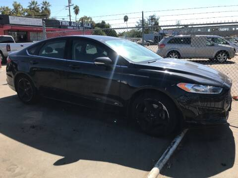 2013 Ford Fusion for sale at BMT Auto Sales in Fresno nul