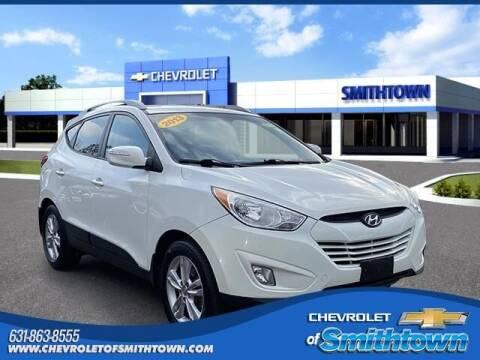 2013 Hyundai Tucson for sale at CHEVROLET OF SMITHTOWN in Saint James NY