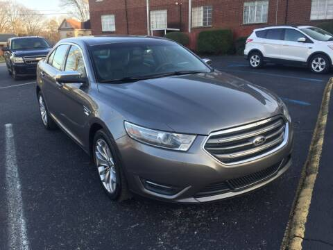 2014 Ford Taurus for sale at DEALS ON WHEELS in Moulton AL