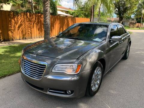 2011 Chrysler 300 for sale at FINANCIAL CLAIMS & SERVICING INC in Hollywood FL