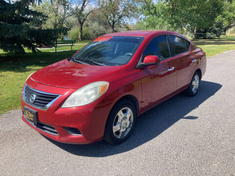 2012 Nissan Versa for sale at BELOW BOOK AUTO SALES in Idaho Falls ID