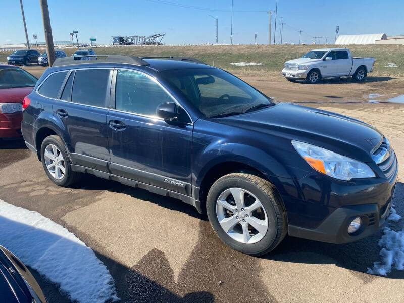 2014 Subaru Outback for sale at BERG AUTO MALL & TRUCKING INC in Beresford SD