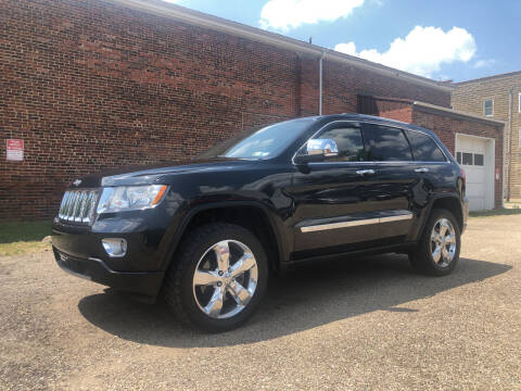 2012 Jeep Grand Cherokee for sale at Jim's Hometown Auto Sales LLC in Byesville OH
