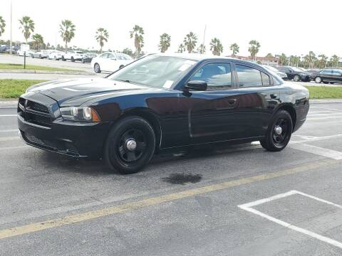 2014 Dodge Charger for sale at L G AUTO SALES in Boynton Beach FL