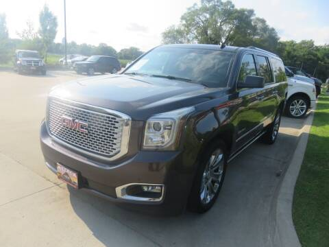 2015 GMC Yukon XL for sale at Azteca Auto Sales LLC in Des Moines IA