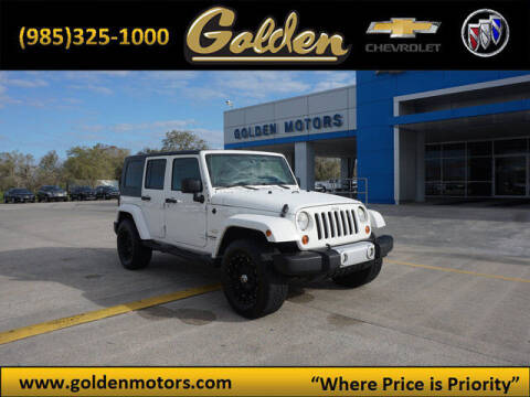 2010 Jeep Wrangler Unlimited for sale at GOLDEN MOTORS in Cut Off LA