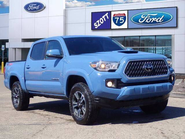 2019 Toyota Tacoma for sale at Szott Ford in Holly MI