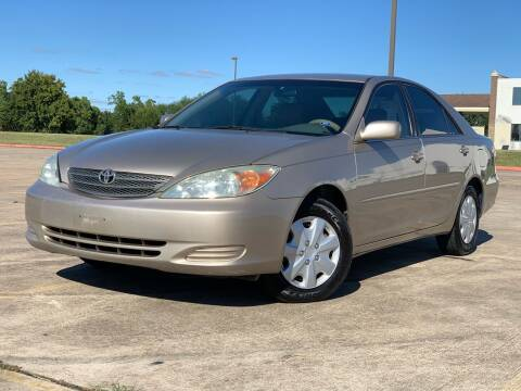 2004 Toyota Camry for sale at AUTO DIRECT Bellaire in Houston TX