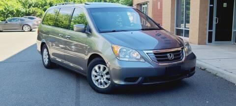 2009 Honda Odyssey for sale at BOOST MOTORS LLC in Sterling VA