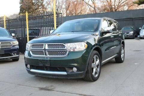 2011 Dodge Durango for sale at F & M AUTO SALES in Detroit MI