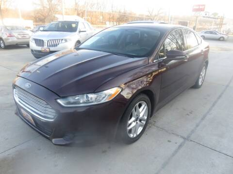 2013 Ford Fusion for sale at Azteca Auto Sales LLC in Des Moines IA