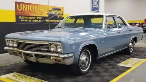 1966 Chevrolet Impala for sale at UNIQUE SPECIALTY & CLASSICS in Mankato MN