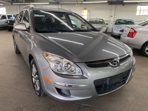 2012 Hyundai Elantra Touring for sale at John Warne Motors in Canonsburg PA