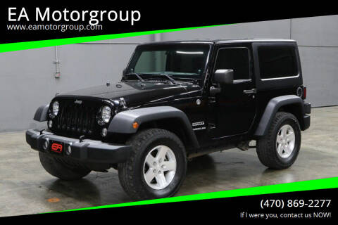 2014 Jeep Wrangler for sale at EA Motorgroup in Austin TX