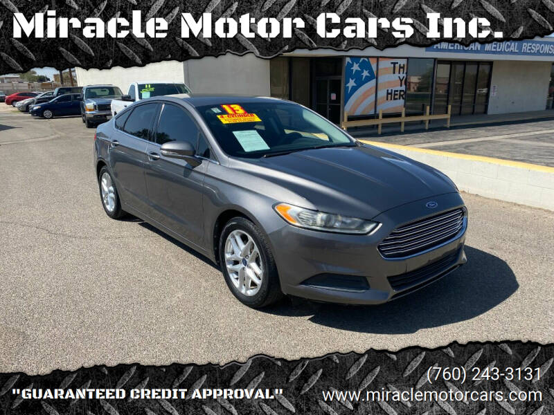 2013 Ford Fusion for sale at Miracle Motor Cars Inc. in Victorville CA
