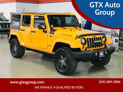 2012 Jeep Wrangler Unlimited for sale at GTX Auto Group in West Chester OH