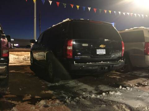 2013 Chevrolet Suburban for sale at BARNES AUTO SALES in Mandan ND