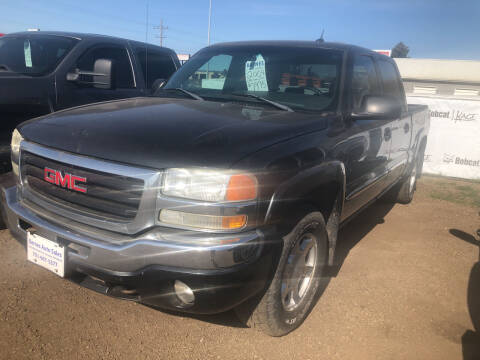 2004 GMC Sierra 1500 for sale at BARNES AUTO SALES in Mandan ND