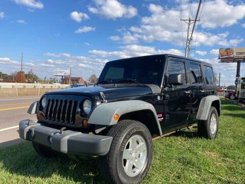 2011 Jeep Wrangler Unlimited for sale at Ace Motors in Saint Charles MO