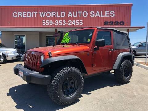 2009 Jeep Wrangler for sale at Credit World Auto Sales in Fresno CA