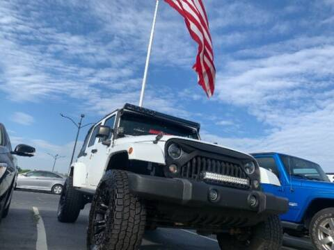 2016 Jeep Wrangler Unlimited for sale at Dixie Imports in Fairfield OH