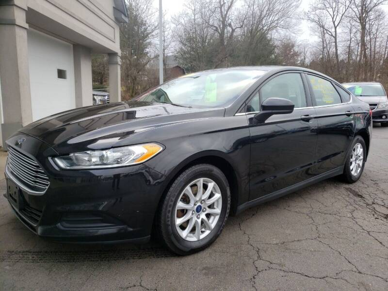 2015 Ford Fusion for sale at STRUTHER'S AUTO MALL in Austintown OH