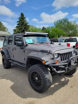 2012 Jeep Wrangler Unlimited for sale at JR Auto in Brookings SD