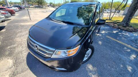 2013 Honda Odyssey for sale at YOUR BEST DRIVE in Oakland Park FL