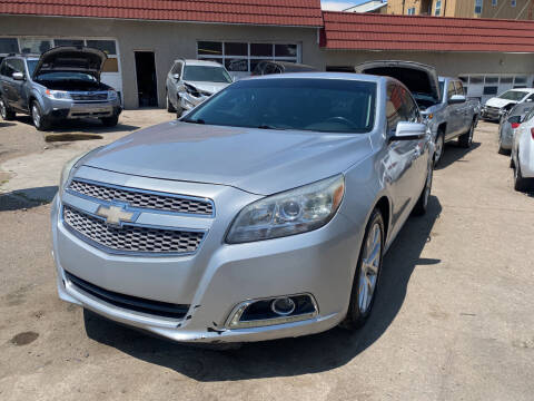 2013 Chevrolet Malibu for sale at STS Automotive in Denver CO