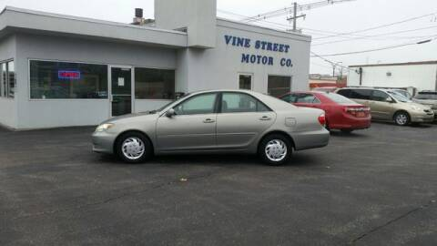2006 Toyota Camry for sale at VINE STREET MOTOR CO in Urbana IL