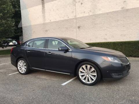 2013 Lincoln MKS for sale at Select Auto in Smithtown NY