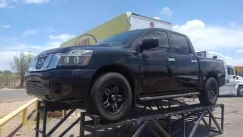 2009 Nissan Titan for sale at CAMEL MOTORS in Tucson AZ