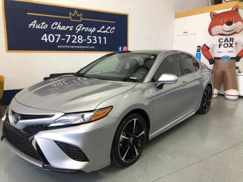 2019 Toyota Camry for sale at Auto Chars Group LLC in Orlando FL