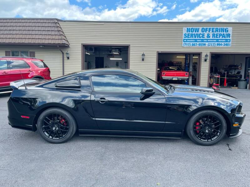 2014 Ford Mustang for sale at MAGNUM MOTORS in Reedsville PA